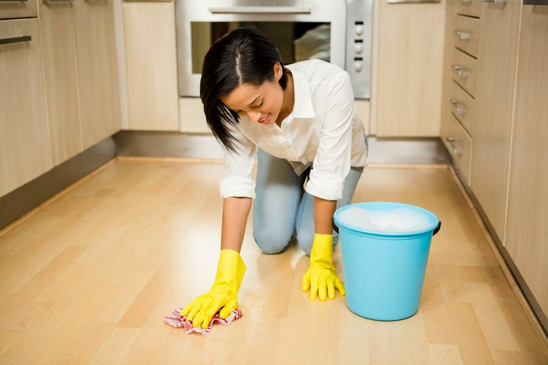 A maid cleaning floor